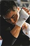 Japanese boxer tying bandage on his knuckles before fight Stock Photo - Premium Royalty-Free, Artist: Mark Tomalty, Code: 622-02913229