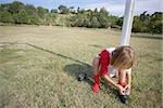 Soccer boy tying his shoelaces Stock Photo - Premium Royalty-Free, Artist: Mark Peter Drolet, Code: 622-02913339