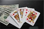 Royal flush in diamond and dollars in studio Stock Photo - Premium Royalty-Free, Artist: Minden Pictures, Code: 622-02913392