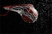 Basketball going through hoop Stock Photo - Premium Royalty-Freenull, Code: 622-02913431