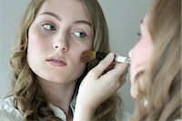 young woman putting on some make-up, portrait Stock Photo - Premium Rights-Managednull, Code: 853-02913531