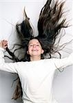 Laughing girl with long dark hair Stock Photo - Premium Rights-Managed, Artist: F1Online, Code: 853-02913636