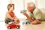 Grandfather and grandson playing with cars Stock Photo - Premium Rights-Managed, Artist: F1Online, Code: 853-02913665