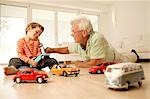 Grandfather and grandson playing with cars Stock Photo - Premium Rights-Managed, Artist: F1Online, Code: 853-02913671