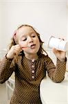 Girl eating yoghurt Stock Photo - Premium Rights-Managed, Artist: F1Online, Code: 853-02913674