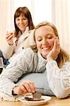 Two women relaxing on floor Stock Photo - Premium Rights-Managed, Artist: F1Online, Code: 853-02913683
