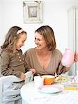 Mother and daughter having fun at breakfast table Stock Photo - Premium Rights-Managed, Artist: F1Online, Code: 853-02913721