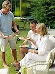 Adults having garden party Stock Photo - Premium Rights-Managed, Artist: F1Online, Code: 853-02913935