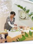 Woman preparing breakfast table Stock Photo - Premium Rights-Managed, Artist: F1Online, Code: 853-02914001
