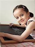 girl writing on a blackboard Stock Photo - Premium Rights-Managed, Artist: F1Online, Code: 853-02914305