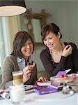Mother and daughter having a drink Stock Photo - Premium Rights-Managed, Artist: F1Online, Code: 853-02914341