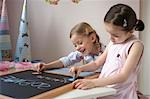Two girls writing on blackboard Stock Photo - Premium Rights-Managed, Artist: F1Online, Code: 853-02914353