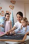 Mother and children writing on blackboard Stock Photo - Premium Rights-Managed, Artist: F1Online, Code: 853-02914356
