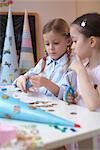 Two girls doing crafts Stock Photo - Premium Rights-Managed, Artist: F1Online, Code: 853-02914359
