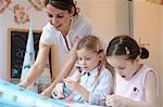 Two girls doing crafts with mother Stock Photo - Premium Rights-Managed, Artist: F1Online, Code: 853-02914362
