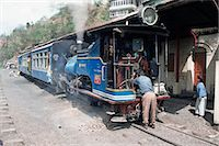 steam engine - Toy train from Darjeeling to plains refuelling at Goom station, West Bengal state, India, Asia Stock Photo - Premium Rights-Managednull, Code: 841-02915601