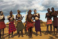 Karo people with body painting, made from mixing animal pigments with clay, dancing, Kolcho village, Lower Omo Valley, Ethiopia, Africa Stock Photo - Premium Rights-Managednull, Code: 841-02917036