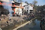 Smoke rising from cremation ceremony on banks of Bagmati River during Shivaratri festival, Pashupatinath Temple, Kathmandu, Nepal, Asia Stock Photo - Premium Rights-Managed, Artist: Robert Harding Images, Code: 841-02917421