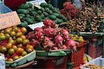 Dragon fruits, oranges and mangoes for sale on a fruit stall at the weekend market in Bangkok, Thailand, Southeast Asia, Asia