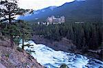 Banff, the Bow Falls and prestigious Banff Springs Hotel, at dusk, Banff National Park, UNESCO World Heritage Site, Alberta, Canada, North America