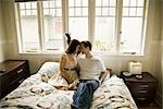 Couple at Home Sitting on Bed                                                                                                                                                                            Stock Photo - Premium Rights-Managed, Artist: Johann Wall              , Code: 700-02922643