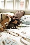 Woman Sitting on the Bed With Her Cat                                                                                                                                                                    Stock Photo - Premium Rights-Managed, Artist: Johann Wall              , Code: 700-02922645