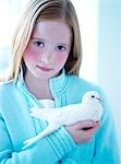 Girl Holding a Dove                                                                                                                                                                                      Stock Photo - Premium Rights-Managed, Artist: Yvonne Duivenvoorden     , Code: 700-02922717