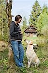 Pregnant Woman Outside With Her Dog                                                                                                                                                                      Stock Photo - Premium Rights-Managed, Artist: Bettina Salomon          , Code: 700-02922762