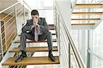 Businessman on office staircase with face in hands Stock Photo - Premium Royalty-Free, Artist: Aflo Relax, Code: 644-02923131