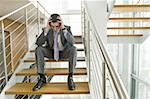 Businessman on office staircase with head in hands Stock Photo - Premium Royalty-Free, Artist: Cultura RM               , Code: 644-02923134