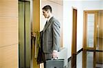 Businessman waiting for the elevator Stock Photo - Premium Royalty-Free, Artist: Lloyd Sutton, Code: 644-02923308