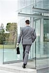 Businessman entering office building Stock Photo - Premium Royalty-Free, Artist: Robert Harding Images, Code: 644-02923374