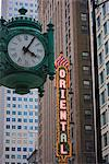 Marshall Field Building Clock and Oriental Theatre sign, Theatre District, Chicago, Illinois, United States of America, North America