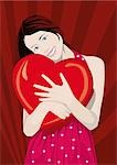 Young woman hugging a heart Stock Photo - Premium Royalty-Freenull, Code: 645-02925827