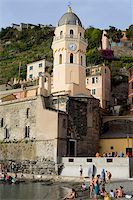 sand clock - Low angle view of a church in a town, Church of Santa Margherita d'Antiochia, Italian Riviera, Cinque Terre National Park, Vernazza, La Spezia, Liguria, Italy Stock Photo - Premium Royalty-Freenull, Code: 625-02927750