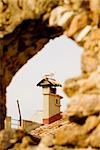 Bird perching on the top of a building viewed through an arch, Musee De La Castre, Cote d'Azur, Cannes, Provence-Alpes-Cote D'Azur, France Stock Photo - Premium Royalty-Free, Artist: ableimages, Code: 625-02928326