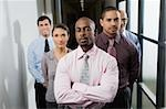 Business executives standing in a corridor Stock Photo - Premium Royalty-Freenull, Code: 625-02929529