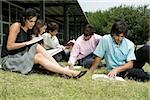 Five university students sitting in a lawn and studying Stock Photo - Premium Royalty-Freenull, Code: 625-02929709
