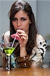 Portrait of a young woman drinking cocktail Stock Photo - Premium Royalty-Free, Artist: Graham French, Code: 625-02930225