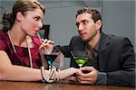 Young couple drinking cocktail and romancing Stock Photo - Premium Royalty-Free, Artist: Glowimages, Code: 625-02930228