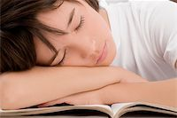 Close-up of a schoolboy sleeping Stock Photo - Premium Royalty-Freenull, Code: 625-02930953