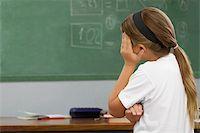 sad girls - Side profile of a schoolgirl looking sad Stock Photo - Premium Royalty-Freenull, Code: 625-02931570
