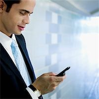 Close-up of a businessman text messaging Stock Photo - Premium Royalty-Freenull, Code: 625-02931718