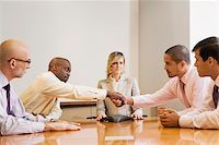 Business executives in a board room Stock Photo - Premium Royalty-Freenull, Code: 625-02932088