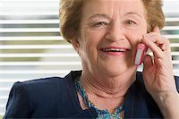 Close-up of a senior woman talking on a mobile phone and smiling Stock Photo - Premium Royalty-Freenull, Code: 625-02932122