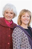 Portrait of a senior woman and a mature woman smiling Stock Photo - Premium Royalty-Freenull, Code: 625-02932564