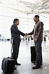 Two businessmen shaking hands at an airport Stock Photo - Premium Royalty-Free, Artist: Jerzyworks, Code: 625-02932594