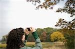 Rear view of a mid adult woman photographing with a digital camera Stock Photo - Premium Royalty-Free, Artist: Lalove Benedict, Code: 625-02932719