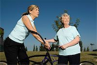Two senior women standing with bicycles Stock Photo - Premium Royalty-Freenull, Code: 625-02933277