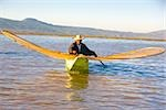 Fisherman with butterfly fishing net in a lake, Janitzio Island, Lake Patzcuaro, Patzcuaro, Michoacan State, Mexico Stock Photo - Premium Royalty-Freenull, Code: 625-02933375